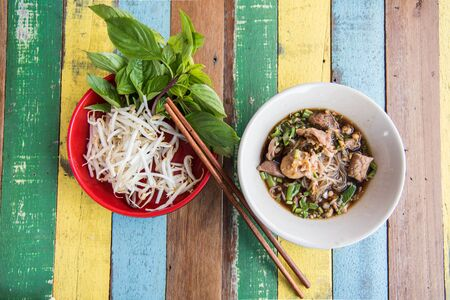 asian style: Thai soup with noodle serve with bean sprout and basil leaf