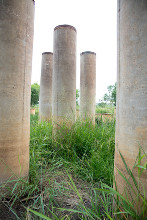 piling: abandon concrete piling in field Stock Photo
