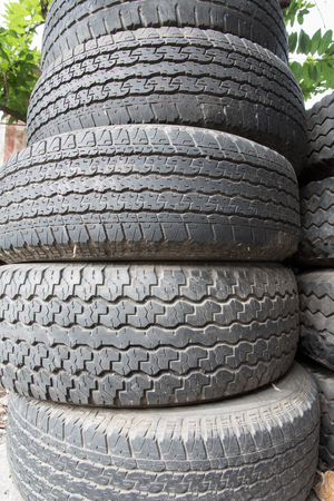 discard: old black tire stack discard Stock Photo
