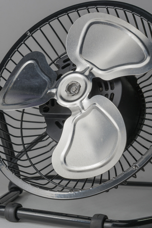 moveable: small electric fan ,household gadget on white background Stock Photo