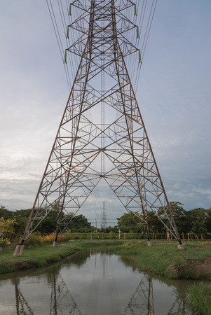electric grid: high voltage electric pole and power cable wiring between