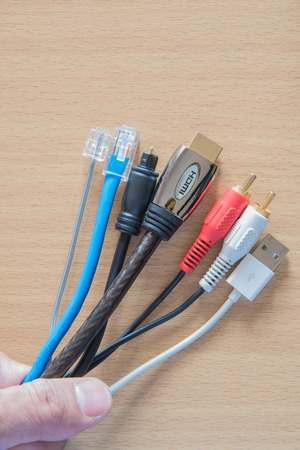usb various: different type of connector on wooden background Stock Photo