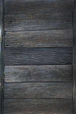 grunge wood: a part of wooden table in the garden, texture of old plank as background Stock Photo