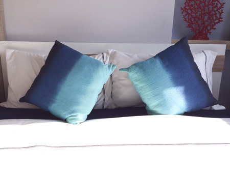 comfortable: Comfortable blue pillows and bed