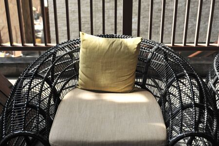 outdoor furniture rattan chairs with pillow on terrace Stock Photo