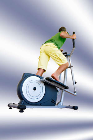 pumping: Pumping hard on a cross-trainer.File includes clipping path.