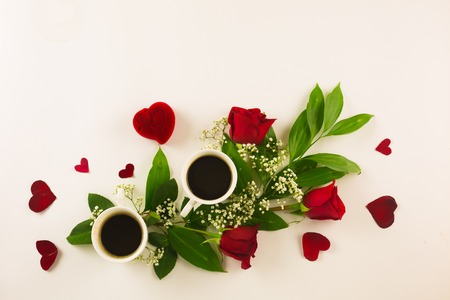Marriage proposal with pearl ring in man hand, red roses and woman hand with coffee Stock Photo