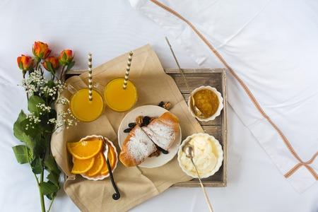 desayuno romantico: Romantic breakfast with love, croissants, coffee, orange juice Foto de archivo
