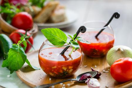 gazpacho: Tomato gazpacho soup with fresh cucumbers, red pepper, green basil, onions Stock Photo