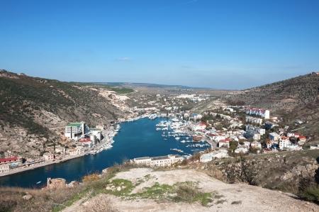 Ukraine, the Crimean Peninsula, Bay of Balaclava, mountainous terrain, pier, resort area Stock Photo