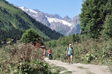 conquer: Hiking tourists to conquer the mountain peaks of the Caucasus