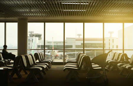 Empty seats in airport lobby, travel concept.