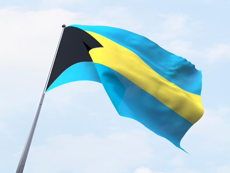 Bahamas flag flying on clear sky. Imagens