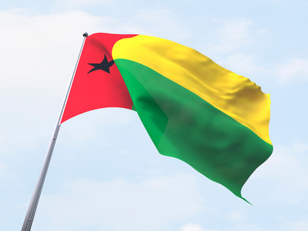 clear sky: Guinea Bissau flag flying on clear sky.
