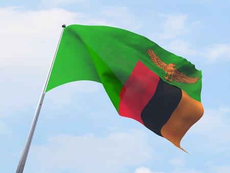 zambia: Zambia flag flying on clear sky. Stock Photo