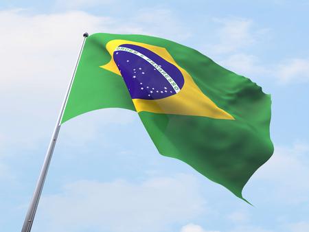 flying flag: Brazil flag flying on clear sky. Stock Photo