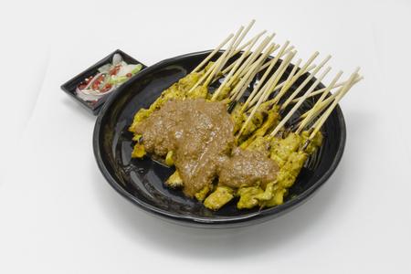 nibbles: Thai food pork satay isolate on white background