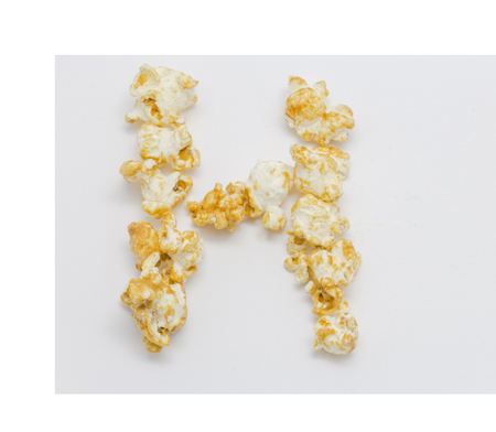 sign h: pop corn forming letter H isolated on white background