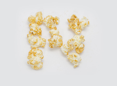 letter word: pop corn forming letter N isolated on white background