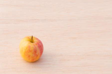 fuji apple on wood background Stock Photo