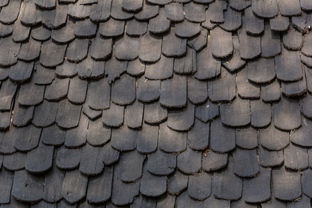 old hand made roof made from black wood, wooden roof.cedar roof