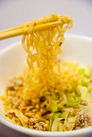 chopsticks,bowl and noodles on white background photo