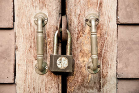 old padlock on old wooden door Stock Photo - 12534814