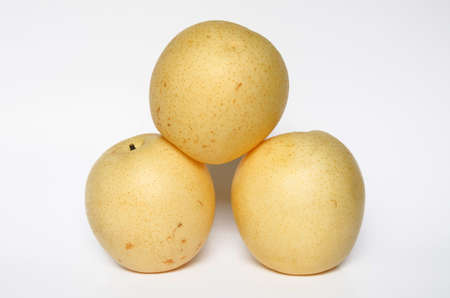 Three yellow pears isolated on the white Stock Photo