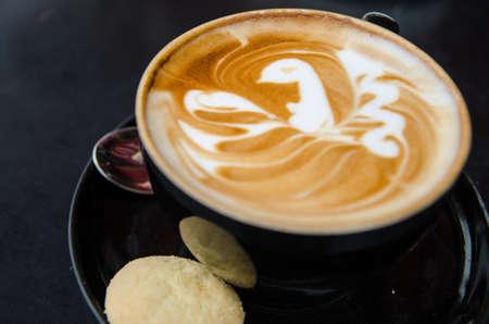 capucinno: A cappuccino with a bird in latte art Stock Photo