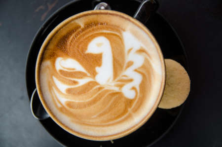 capacino: A cappuccino with a bird in latte art Stock Photo