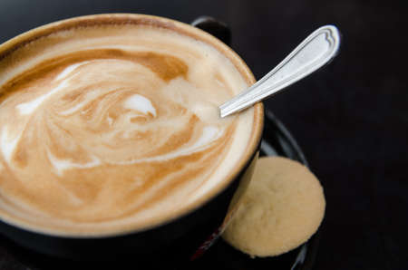 crema: Cup of caffe crema with biscotti