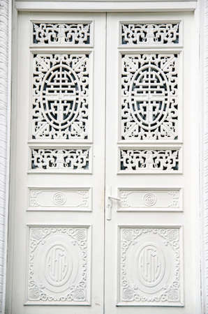receded: A modern single wooden door painted in white