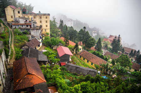 Sapa valley city in the mist, Vietnam photo