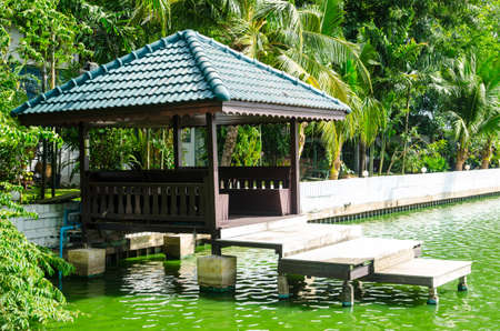waterside: waterfront pavilion beside canal Thailand Stock Photo