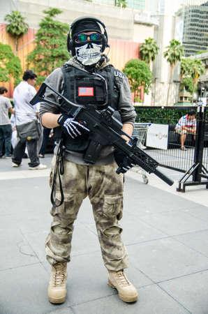 counter terrorism: BANGKOK - SEPTEMBER 1   A cosplayer dressed as a soldier attends an informal cosplay meet in Japan Festa in Bangkok 2013 on September 1, 2013 at Central Word, Bangkok, Thailand Editorial
