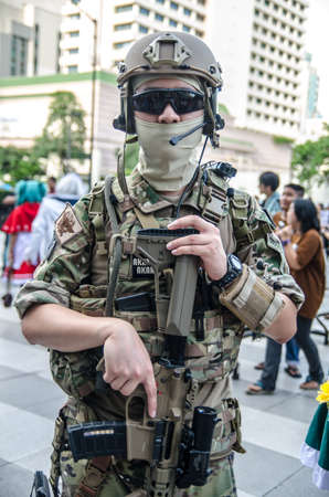 BANGKOK - SEPTEMBER 1   A cosplayer dressed as a soldier attends an informal cosplay meet in Japan Festa in Bangkok 2013 on September 1, 2013 at Central Word, Bangkok, Thailand