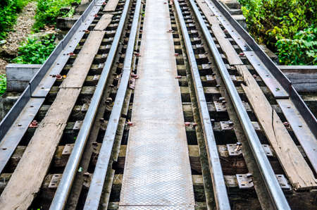 Rails with wooden sleepers Stock Photo