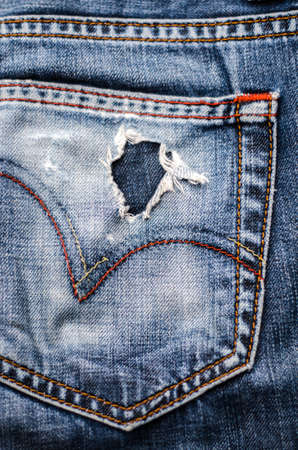 blue jeans: blue jean texture with a hole and threads showing