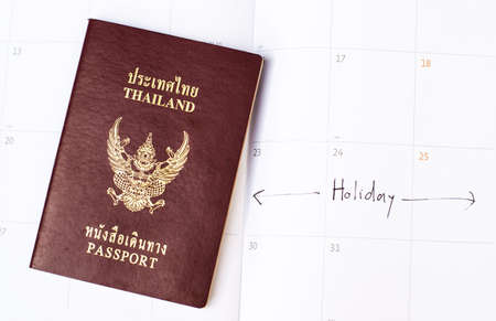 passport on the calender with vacation text photo