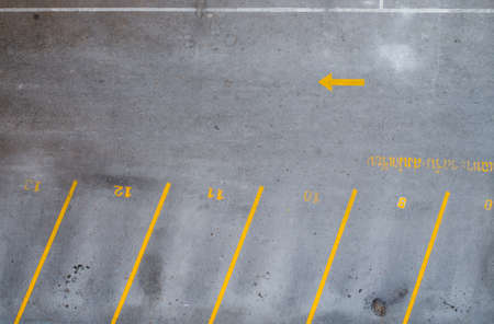 Empty parking lot with yellow lines photo