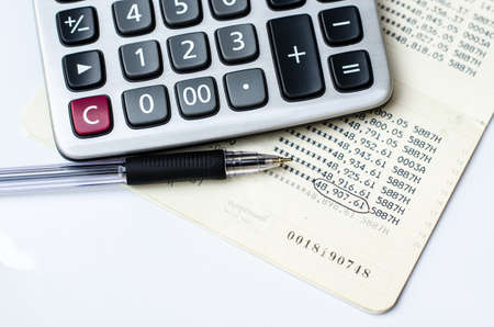 cash flow statement: Calculations and account book and pen