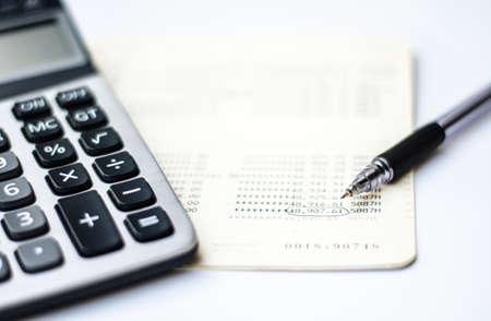 total loss: Calculations and account book and pen