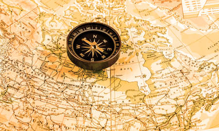 Vintage compass over map