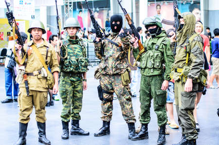 BANGKOK, THAILAND - AUGUST 31:  A cosplayer dressed as a soldier attends an informal cosplay in Japan festa in Bangkok on August 31, 2014 at Central World, Bangkok, Thailand.