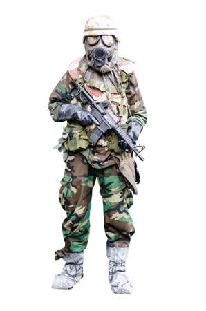 belonging to the caucasoid race: Special force soldier wearing gask mask with rifle  standing in isolation background