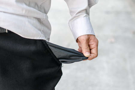 Business man showing close up his empty pocket