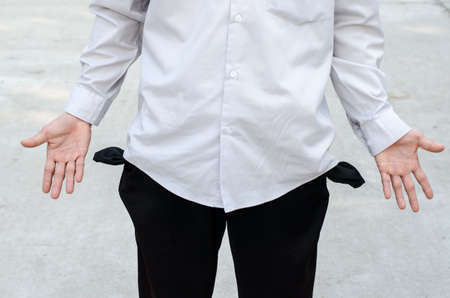 empty pocket: Business man showing his empty pocket Stock Photo