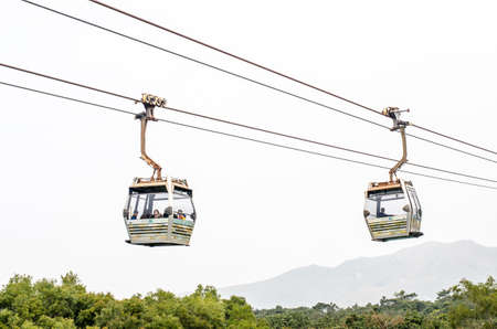 HONG KONG - 2015  February 7 : Cable cars of Ngong Ping on Lantau island of Hong Kong on February 7, 2015. Lantau is the largest island in Hong Kong, located at the mouth of the Pearl River. Editorial