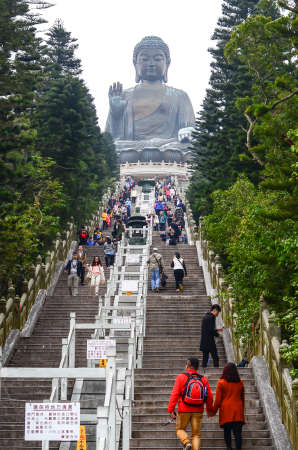 buddhism prayer belief: HONG KONG - February 06, 2015 : Tian Tan Giant Buddha from Po Lin Monastery, Lantau Island in Hong Kong on February 06, 2015 . It is a major centre of Buddhism in Hong Kong, and is also a popular tourist attraction Editorial