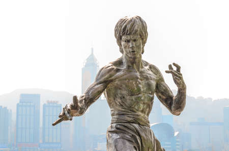 honours: HONG KONG, CHINA - FEB 08: Bruce Lee Statue in Avenue of Stars on February 08, 2015 in Hong Kong, China. The promenade honours celebrities of the Hong Kong film industry as the famous city attraction.